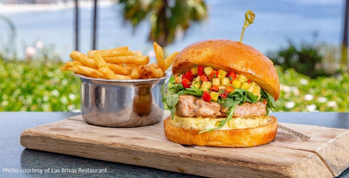 AHI TUNA BURGER -seared ahi tuna, charred pineapple-mango relish, chipotle aioli, served with battered fries